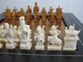 Chinese Brown and White Ivory Chess Set, mid 20th century